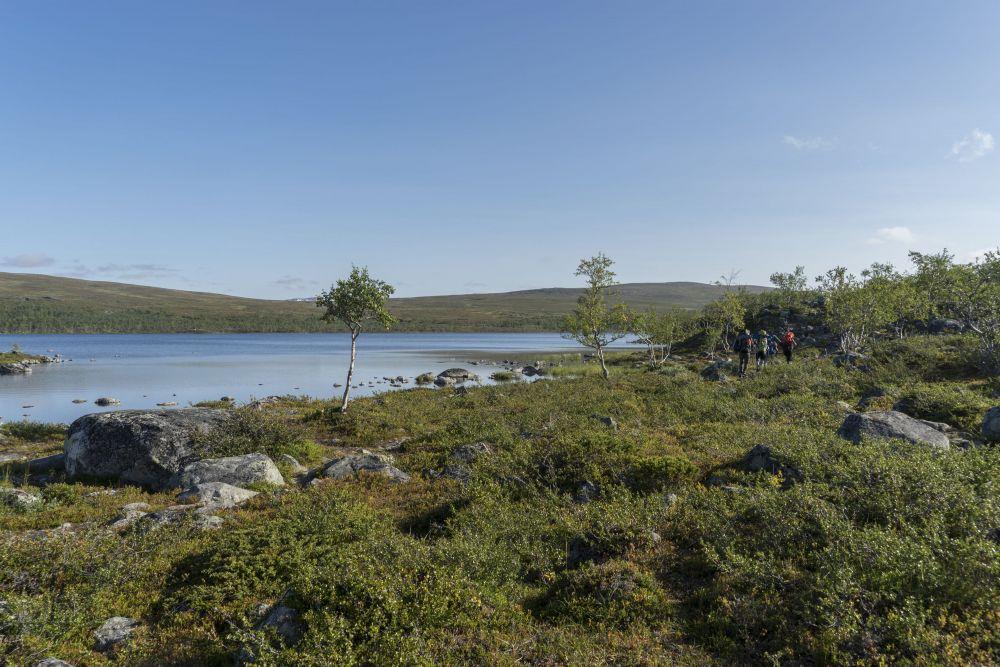 Hiking besides a blue lake